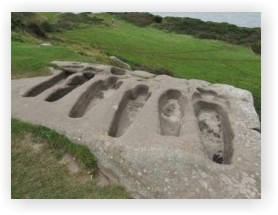 Remains of early medieval rock-cut graves at Heysham Head
