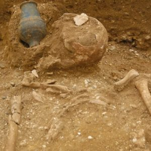This individual had been buried with a complete pottery vessel next to their head.