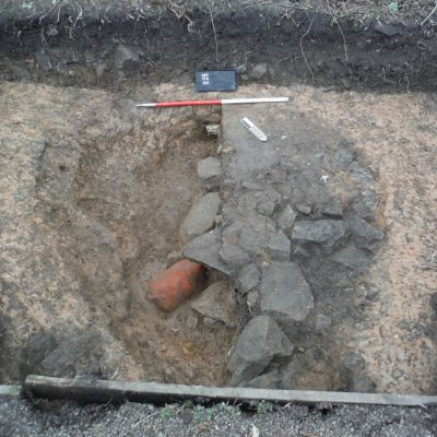A large circular pit excavated in Trench 10 that was found to contain a number of large cobbles as well as a large lump of red ochre. © Copyright ARS Ltd 2018