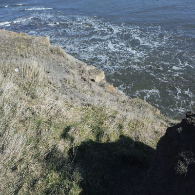 Structural remains eroding from the cliff at Sandsend. © Copyright ARS Ltd 2018