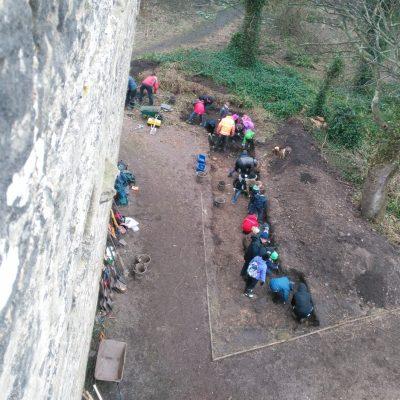 Volunteers hard at work excavating Trench 10 beside the pele tower.
