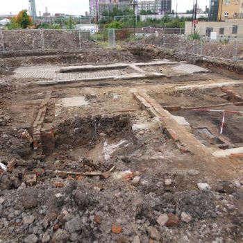 An open area excavation in the centre of Manchester revealed the remains of workers' housing dating to the 19th and 20th centuries. © Copyright ARS Ltd 2018