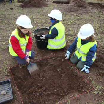 Primary school children helping to excavate test pits. © Copyright ARS Ltd 2018
