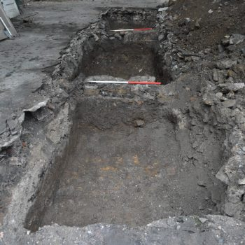 Trench 5 showing wall foundations (scales = 1m).