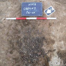 Cremation 7 prior to excavation (scale = 0.5m). © Copyright ARS Ltd