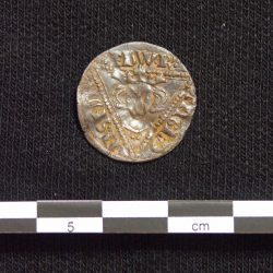 One side of the silver penny from Edward I's reign found during fieldwalking (scale = 5cm). © Copyright ARS Ltd