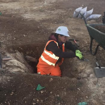 Ana working on the Roman Iron Age palisade construction trench. © Copyright ARS Ltd
