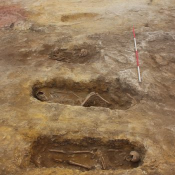 Five of the eleven early medieval graves. Note the preservation of the rock-cut graves in the foreground compared to those that had been cut into sand, in the background, and had therefore suffered more damage due to ploughing (scale = 2 x 2m). © Copyright ARS Ltd