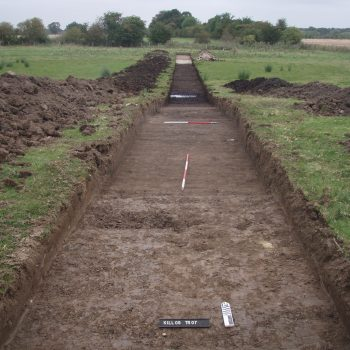 This trench, excavated as part of the 2009 evaluation, shows a dark peat deposit about halfway along its length. © Copyright ARS Ltd
