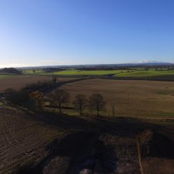 A drone photograph looking over the kettle hole westwards towards the A1 trunk road. © Copyright ARS Ltd