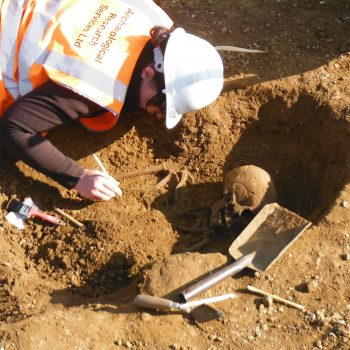 Caitlin excavating one of the skeletons at Black Cat Quarry. © Copyright ARS Ltd