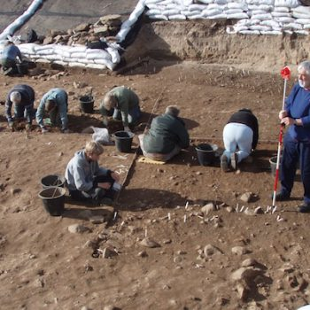 Volunteers excavating a Mesolithic hut scoop at Low Hauxley. © Copyright ARS Ltd 2020