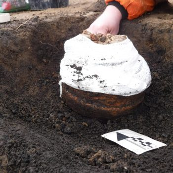 Collared Urn cremation during excavation.