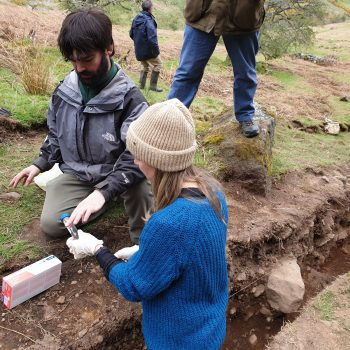 Specialists from the University of Tromsø Museum taking samples from the fill of one of the terraces.