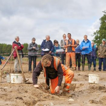 A member of our team excavating as visitors from the open day look on. © Copyright Sam Devito