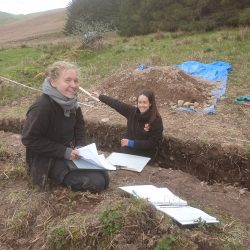 ARS Ltd staff recording the section of the trench.