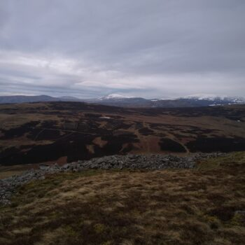 View of the SE rampart of Yeavering Bell hillfort across the northern Cheviots. © Copyright ARS Ltd 2021.