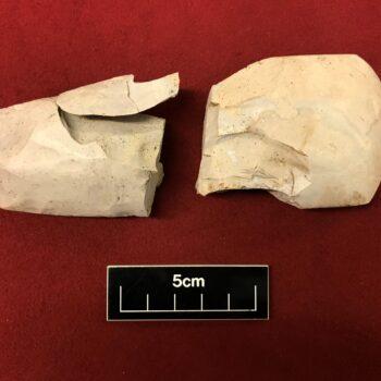A broken axe head. © Copyright ARS Ltd 2021.